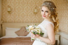 Pretty young Bride. Boudoir morning of the bride. Looks to the camera stock photos