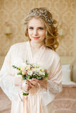 Pretty young Bride. Boudoir morning of the bride. Stock Photos