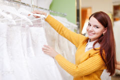 Pretty young bride choosing wedding dress Royalty Free Stock Images