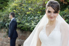 Pretty Young Bride in Elegant Wedding Gown Stock Images