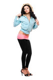 Pretty young brunette in a black leggings. Isolated Royalty Free Stock Photos