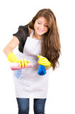 Pretty young brunette girl cleaning Royalty Free Stock Images