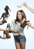 Pretty young brunette loving shoes Stock Images