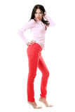 Pretty young brunette in red jeans Stock Image