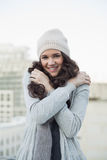 Pretty young brunette shivering Stock Images