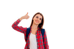 Pretty young brunette students teenager in stylish clothes and backpack on her shoulders posing isolated on white.  Stock Photos
