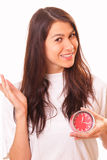 Pretty young brunette woman with alarm clock Royalty Free Stock Photos