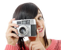Pretty young brunette woman with antique camera Stock Photos