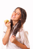 Pretty young brunette woman with an apple Stock Photo