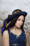 Pretty young brunette woman in blue hat portrait Royalty Free Stock Images