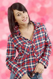 Pretty young brunette woman with checkered shirt Royalty Free Stock Photo