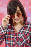 Pretty young brunette woman with checkered shirt Royalty Free Stock Photos