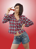 Pretty young brunette woman with a checkered shirt Stock Photography