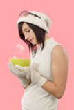 Pretty young brunette woman with a cup of tea Stock Photos