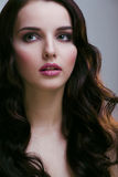 Pretty young brunette woman with hair style like cute doll Royalty Free Stock Photography
