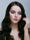 Pretty young brunette woman with hair style like cute doll Stock Photos
