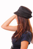 Pretty young brunette woman in a hat Stock Images