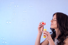 Woman and soap bubbles Royalty Free Stock Images
