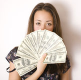 Pretty young brunette woman with money cash Stock Images