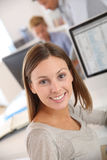 Pretty young brunette woman in office Royalty Free Stock Photo