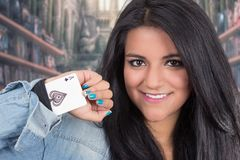 Pretty young brunette woman posing with deck of. Pretty young brunette woman posing with an ace card hidden under her sleeve Royalty Free Stock Image