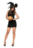 Pretty young brunette woman with a pumpkin Stock Photos