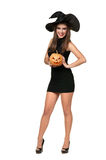 Pretty young brunette woman with a pumpkin stock photography