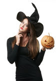 Pretty young brunette woman with a pumpkin Royalty Free Stock Image