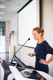 Pretty, young business woman giving a presentation Royalty Free Stock Image