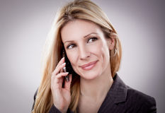 Pretty young business woman has a call Stock Photo