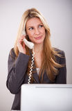 Pretty young business woman has a call Stock Photos