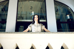 Pretty young business woman, leaning on railing Royalty Free Stock Image