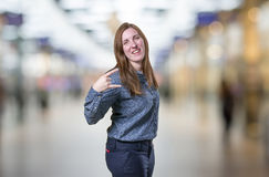 Pretty young business woman making horn gesture Royalty Free Stock Photography