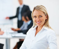 Pretty young business woman smiling Royalty Free Stock Photos