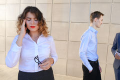 Pretty young business woman, student holds on head from fatigue,. Pretty young perspective business woman, student holds on head from fatigue, rests, took break Stock Images