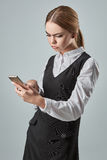 Pretty young business woman using mobile phone indoor Stock Image