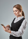 Pretty young business woman using mobile phone indoor Royalty Free Stock Image