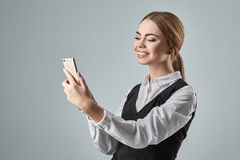 Pretty young business woman using mobile phone indoor Royalty Free Stock Photo
