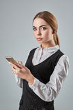 Pretty young business woman using mobile phone indoor Royalty Free Stock Photography