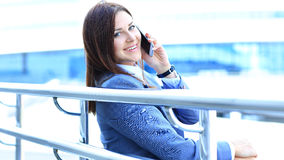 Pretty young business woman using mobile phone Stock Images