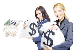 Pretty young business women holding sacks of money Stock Photo