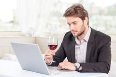 Pretty young businessman is preparing for meeting Royalty Free Stock Images