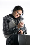 Pretty young businesswoman busy holding many items Stock Photography