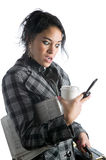Pretty young businesswoman busy holding many items Royalty Free Stock Image