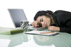 Pretty young businesswoman fallen asleep Royalty Free Stock Images