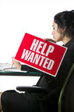 Pretty young businesswoman with a Help Wanted sign Royalty Free Stock Image