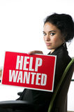 Pretty young businesswoman with a Help Wanted sign Stock Images