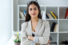 Pretty young businesswoman looking at camera in the office. Stock Images