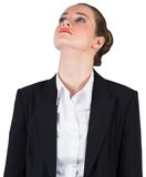 Pretty young businesswoman looking up Royalty Free Stock Images