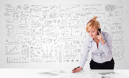 Pretty businesswoman planning and calculating various business i Stock Images
